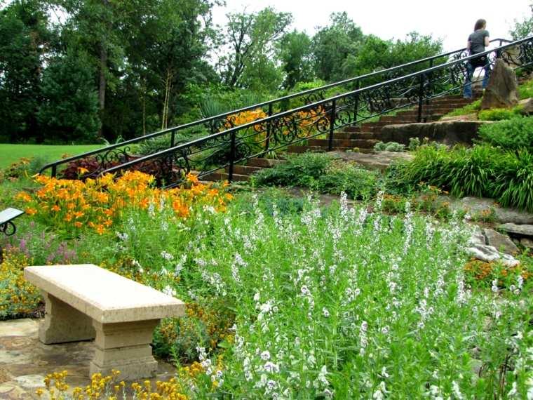 diseño de jardines terrazas banco piedra flores ideas