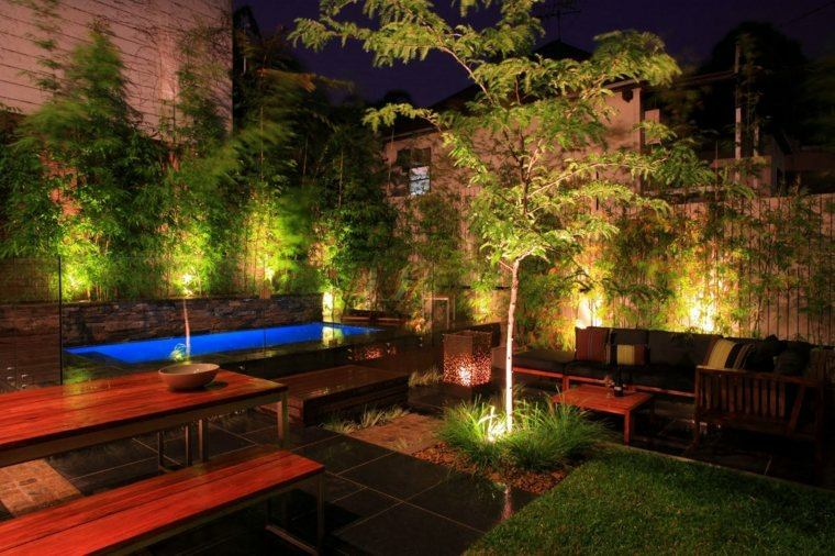 Dise o de jardines 100 ideas de terrazas en el jard n for Iluminacion arboles jardin