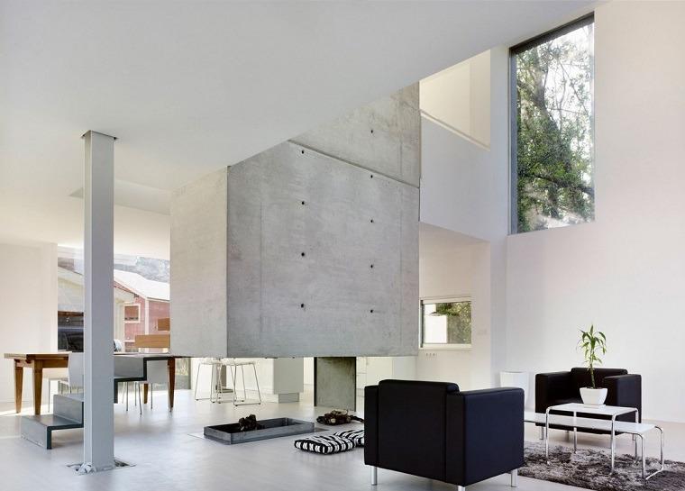 diseno minimalista interior chimenea sillones negros ideas