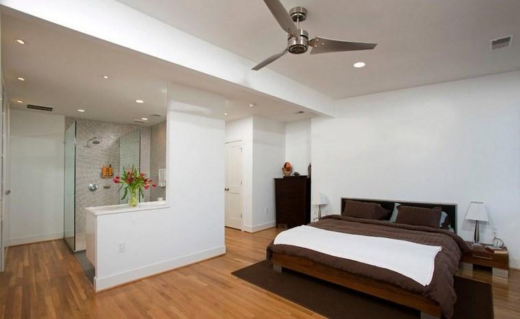dormitorios con vestidor y baño cama madera negra ideas
