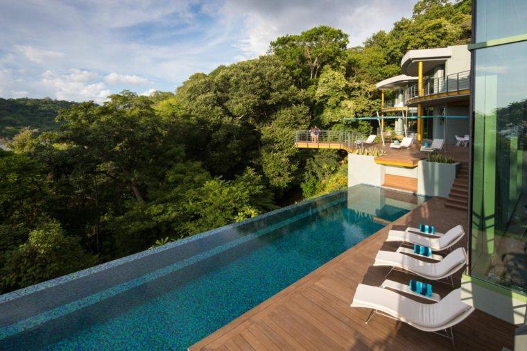 edificio moderno piscina infinita