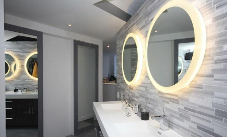 imagenes de banos modernos amplio espejos forma redonda iluminacion LED ideas