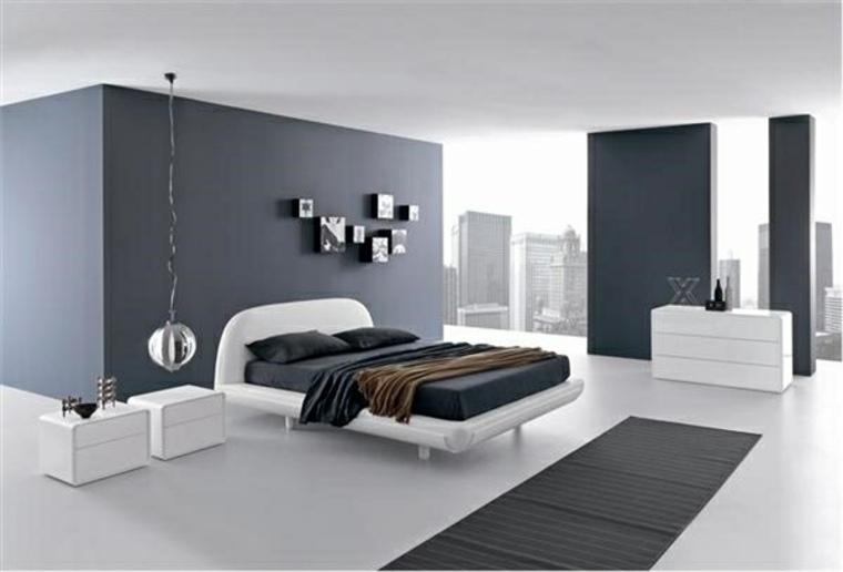 interiores minimalistas dormitorio cama blanca alfombra negra ideas