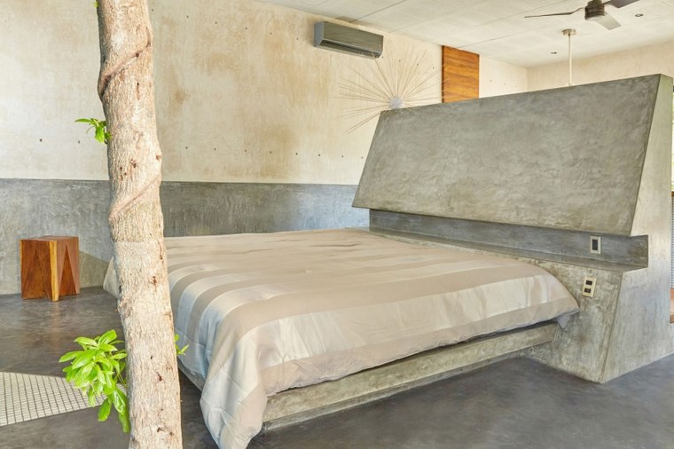 mexico casa diseno dormitorio cama respaldo hormigon ideas