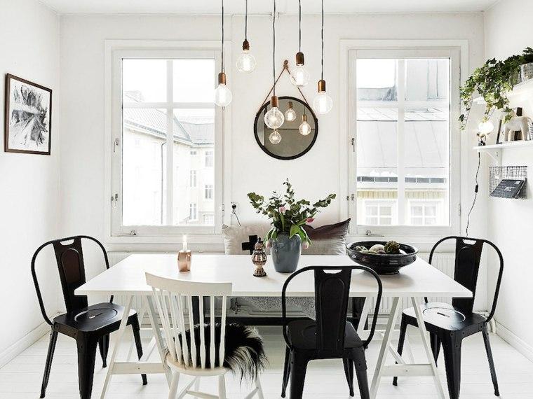 Diseño de comedor con accesorios decorativos en blanco y negro