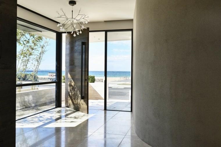 puertas pivotantes cristales lados entrada ideas