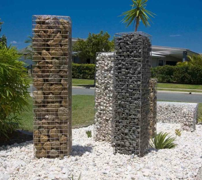 rocas rejas metales salidas palmeras