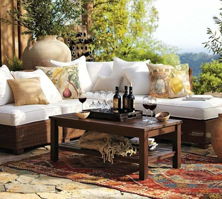 sofá de exterior alfombra cojines blanco ideas