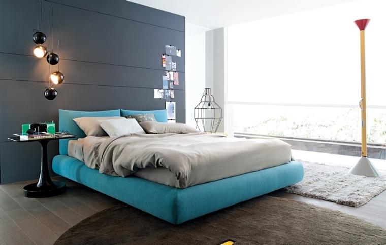 cama acolchada color azul turquesa