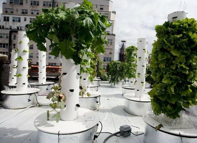columnas modernas jardineras verticales diseño