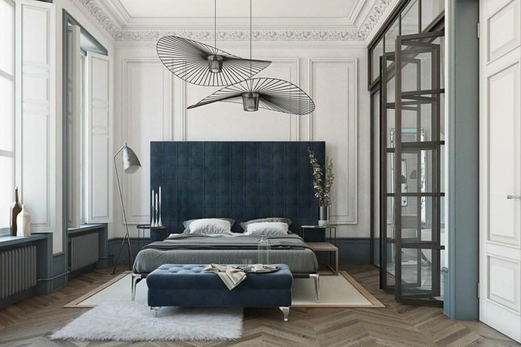 cuarto cama cabecero tapizado azul