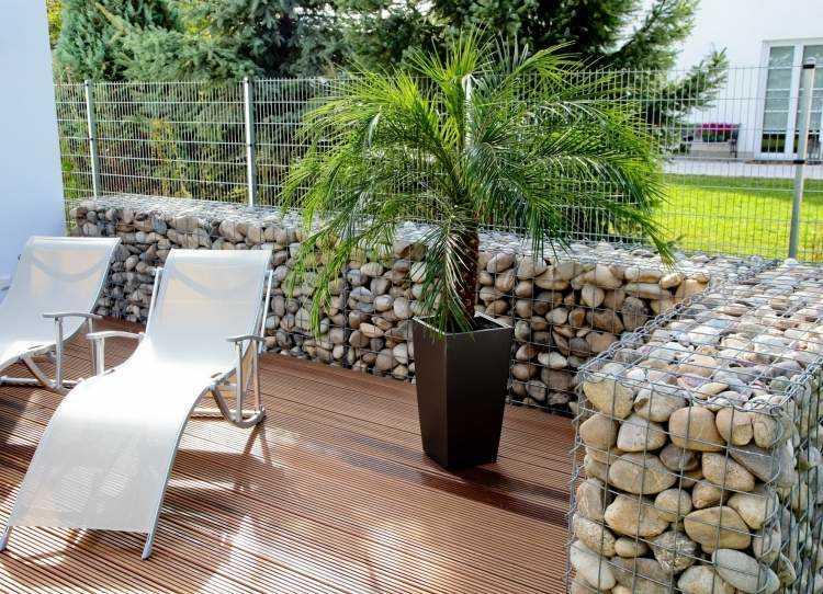diseños muros terraza piedras rediondas
