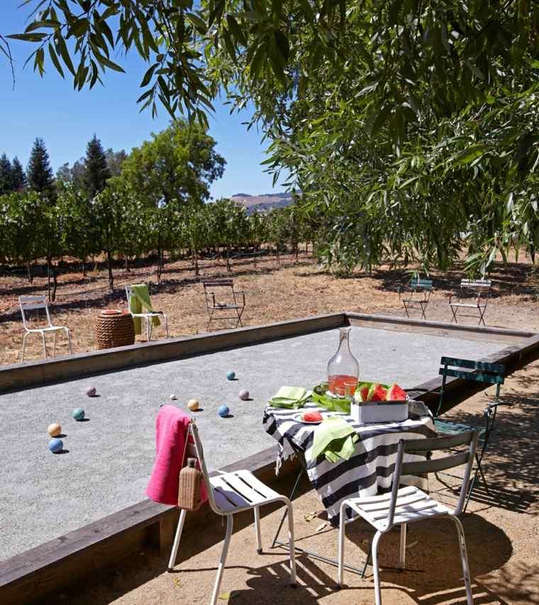 diseño de jardines area juegos sillas acero ideas