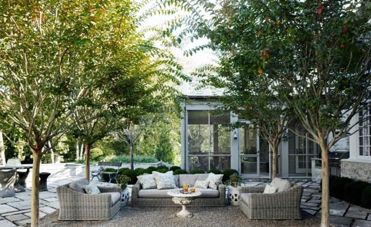 diseño de jardines mesa muebles rattan suelo piedras ideas