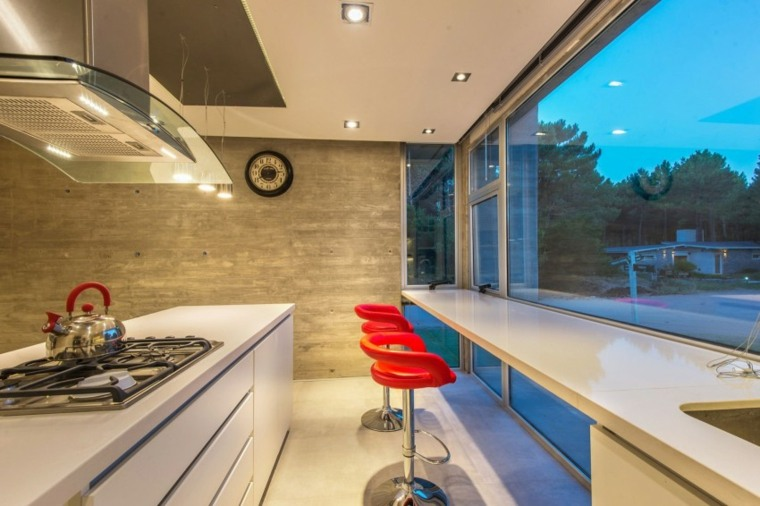 esfecto optico pared hormigon cocina taburetes rojos ideas