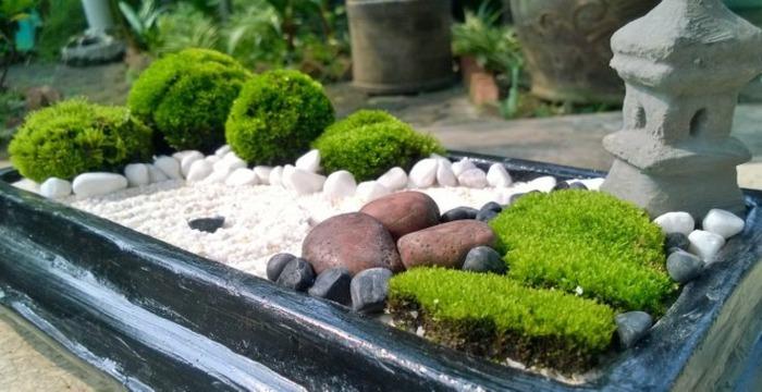 jardin zen detalles lamparas rocas grava