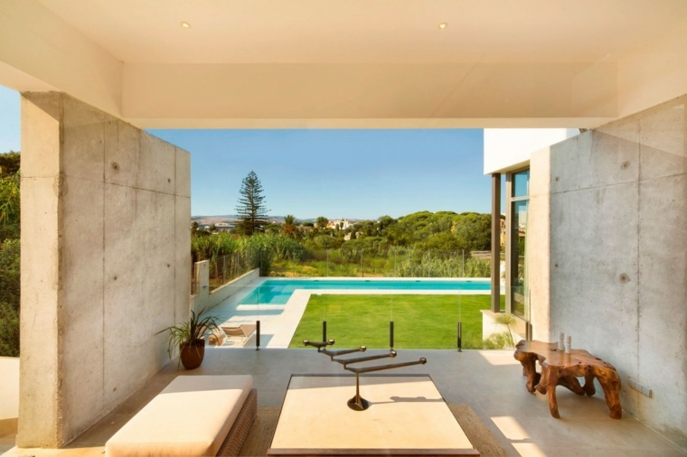 jardines modernos con piscina forma L ideas