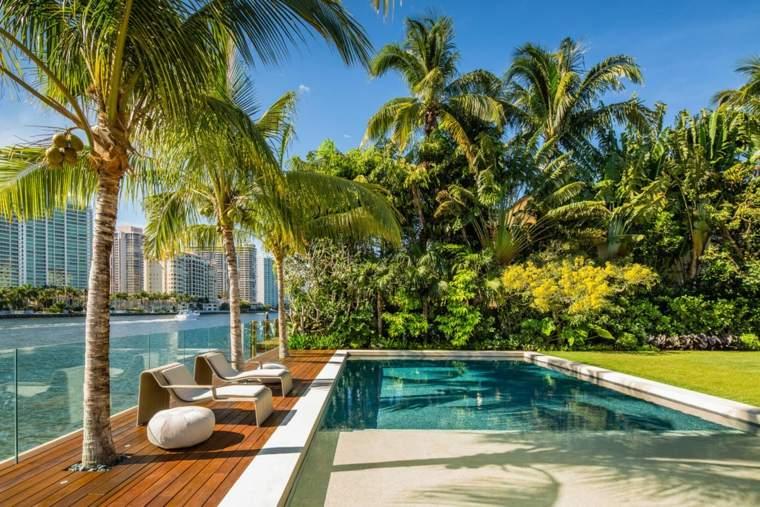 Jardines modernos con piscina 50 dise os radiantes for Patios modernos con piscina
