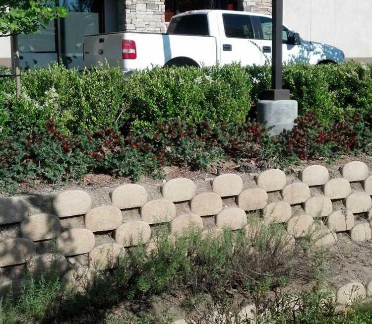 muro jardin bloques cemento verdura