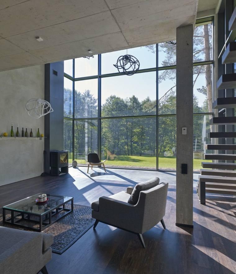 pared hormigon casa ventanales sillones grices