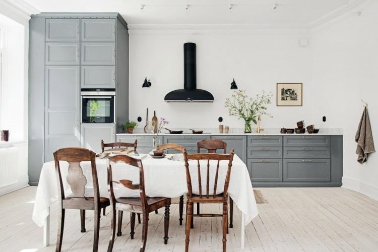 paredes muebles sillones grises negro