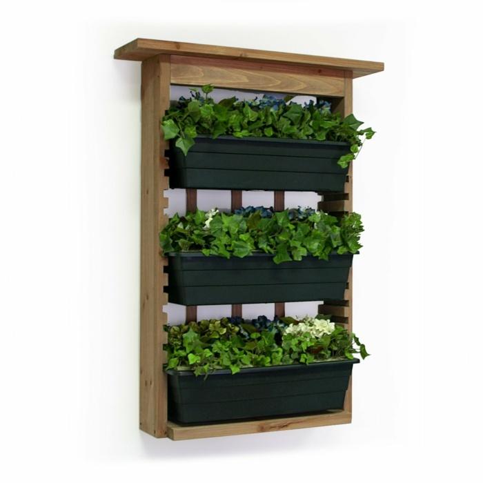 Veintidos ideas de jardines verticales y macetas colgantes for Macetas para pared
