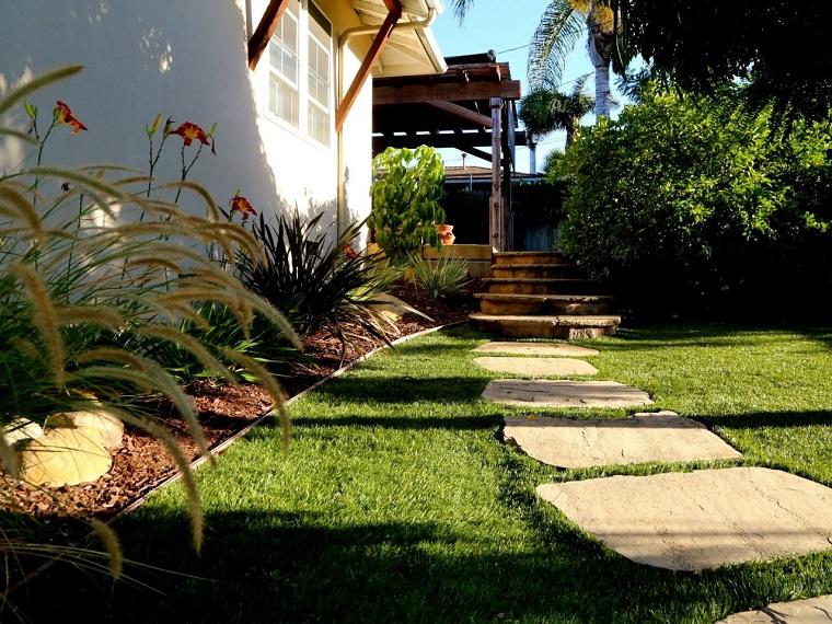 caminos jardin cesped piedras plantas ideas