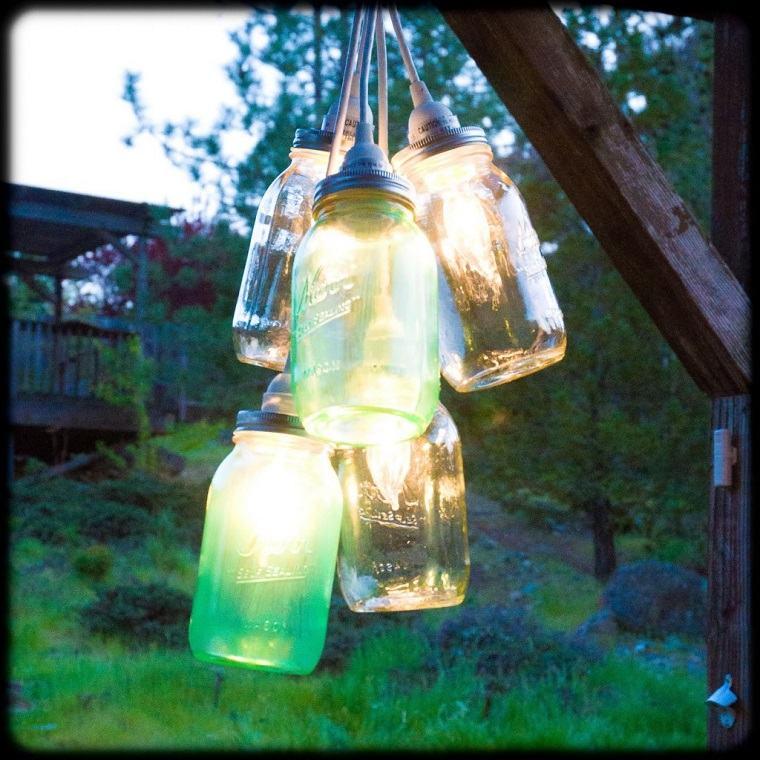candelabros velas iluminacion noche jardin ideas