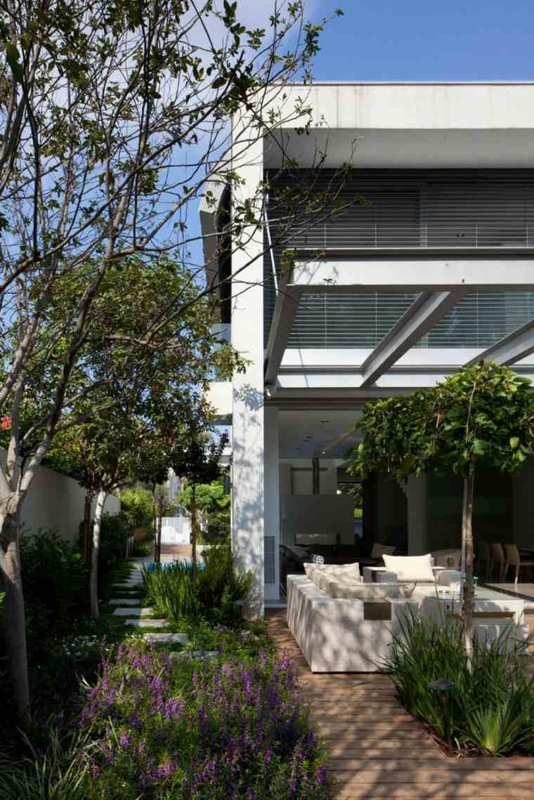 como hacer un jardin bonito estrecho Domb Architects ideas
