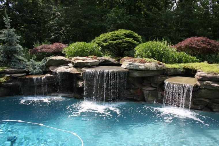 fuente rocas planas jardin piscina