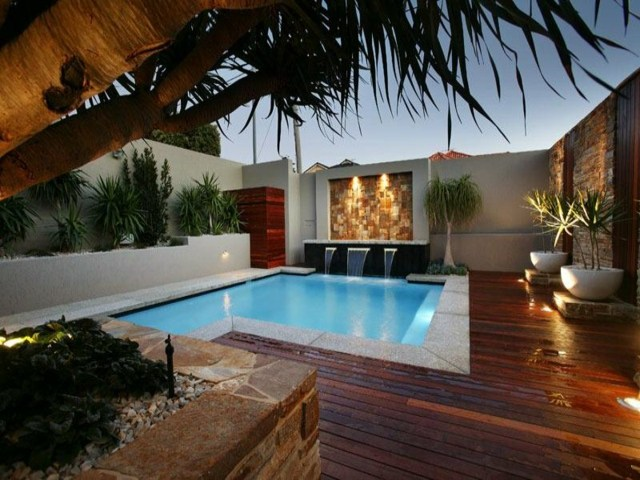 iluminacion jardin piscina macetas opciones ideas