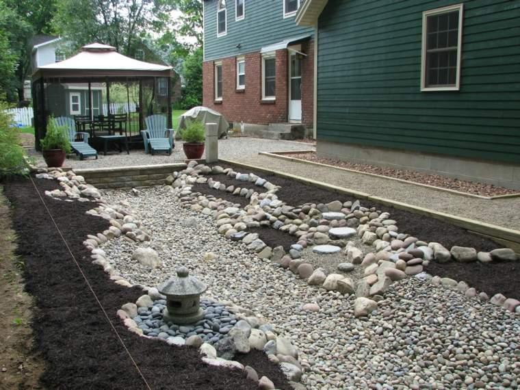 jardin rocas río piedras arena