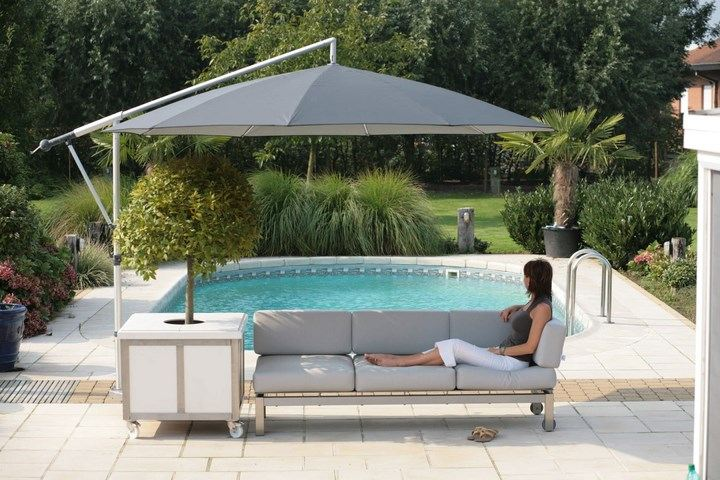 sombrillas sol aire libre sofa piscina jardin ideas