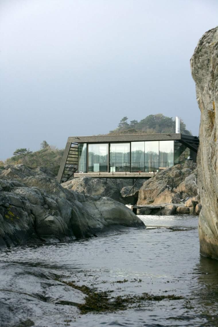 casa lujosa acantilado rocas isla