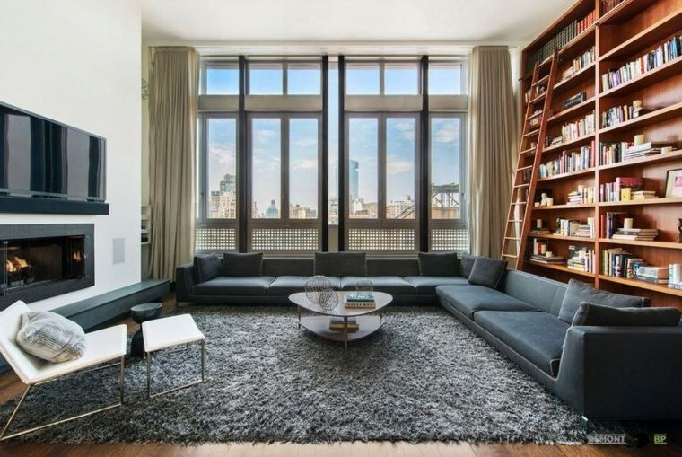 estupenda biblioteca madera salon escaleras