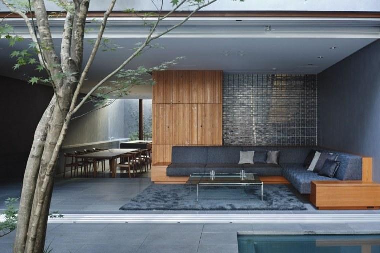 ladrillos sillones madera cojines arboles