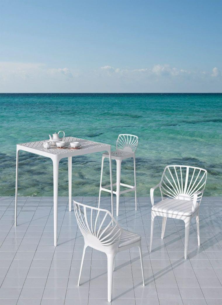 Mesas originales de dise o aptos para exteriores for Sillas de diseno blancas
