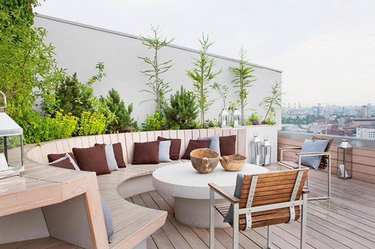 como decorar terraza banco forma ovalada mesa hormigon ideas