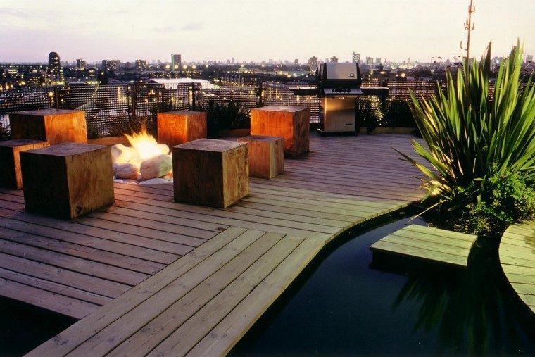 como decorar terraza taburetes madera fuego ideas