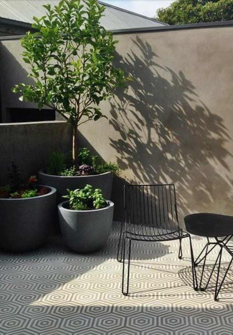 decorar la terraza maceteros modernos