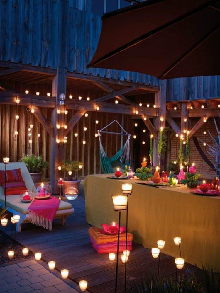 decorar terraza muchas velas