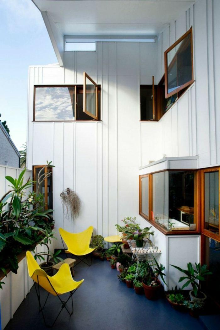 muebles balcon pequeno moderno sillones amarillos ideas