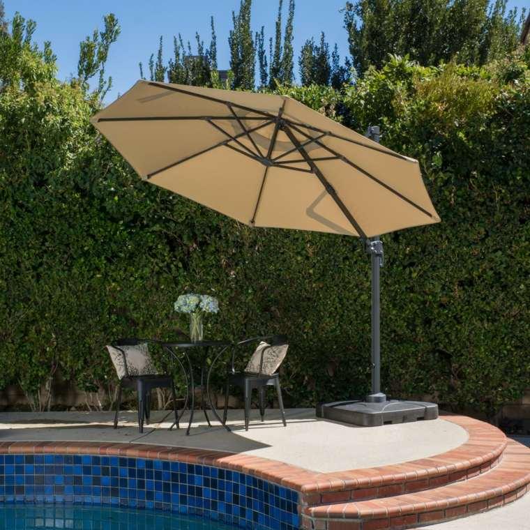 Sombra y luz 24 opciones de p rgolas y sombrillas a la moda for Sombrillas para piscinas