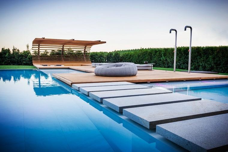 zona de comfort jardin moderno piscina camino losas ideas