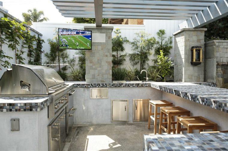 Bares y cocinas en el jard n 24 ideas para inspirarte - Barra de bar exterior ...