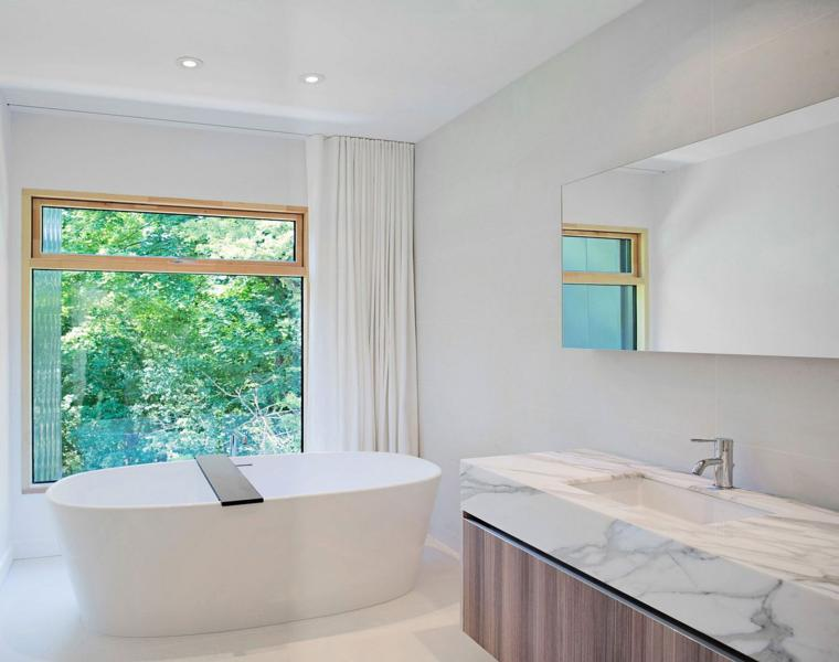 Baño Pequeno Original:Se ha logrado un delicado equilibrio entre un hogar contemporáneo que