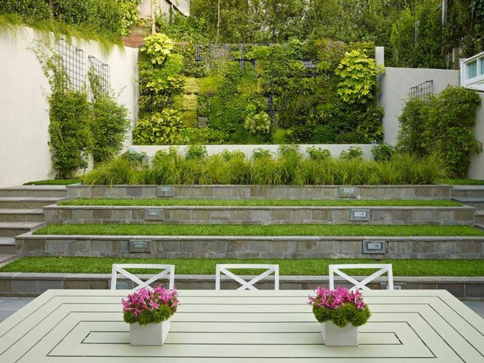 diseño multinivel paredes verdes suelos rosa
