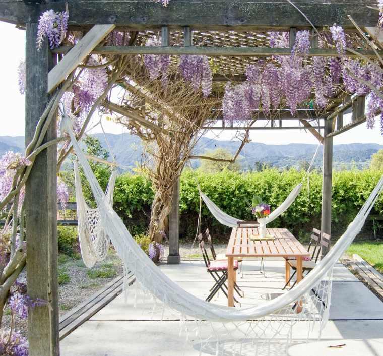 Ideas para el jard n inspiradas en el descanso y la - Hamacas para jardin ...