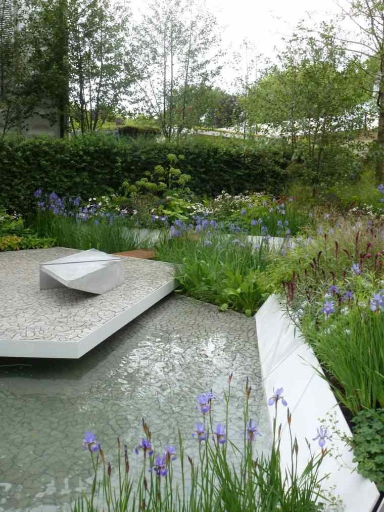frontera losas blancas protege plantas agua ideas