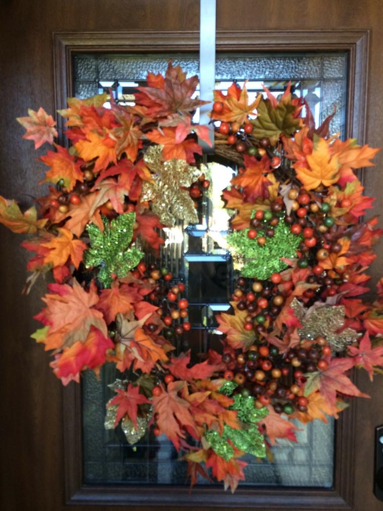 guirnalda corona puerta hojas secas